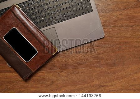 Top View Of Diary, Mobile Phone And Laptop