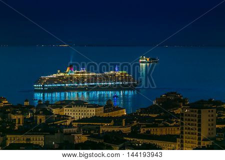 Harbor and cruise ship at night in Trieste Italy