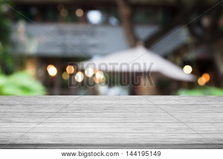 Top of black and white wooden table with cafe blurred abstract background