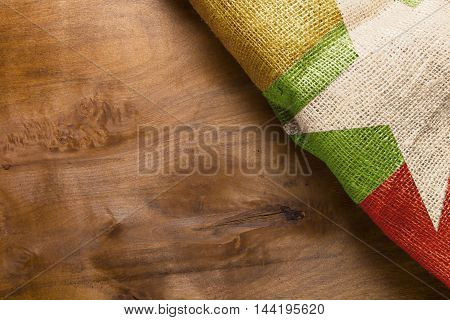 Burma flag state on the wooden background.