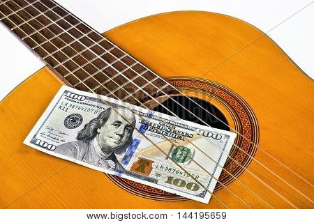 Play for money with guitar and cash.