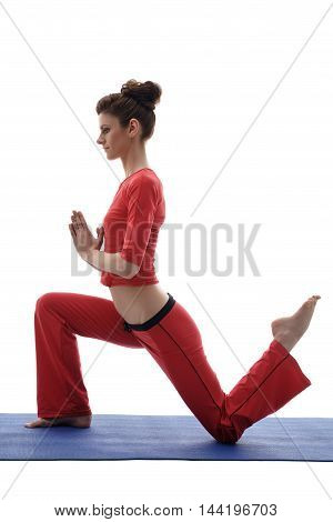 Side view of yoga instructor exercising in studio. Isolated on white