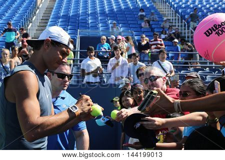 NEW YORK - AUGUST 23, 2016: Grand Slam champion Rafael Nadal of Spain signing autographs after practice for US Open 2016 at Billie Jean King National Tennis Center