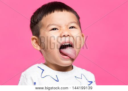 Excited little by showing his tongue