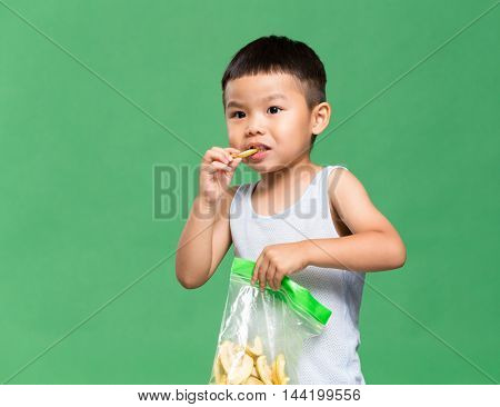 Little boy eating snack