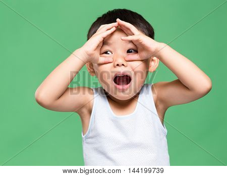 Excited little asian boy