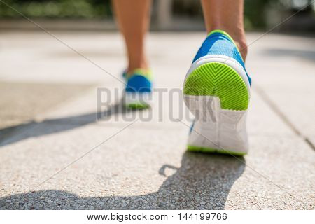 Sport woman running in a city