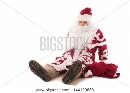 Russian Santa Claus felt boots, wearing a red coat and a bag of gifts