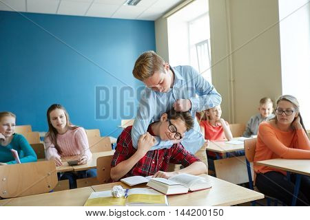 education, bullying, violence, aggression and people concept - student boy suffering of classmate mockery