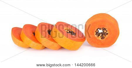 sliced papaya on a white background food