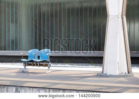 Empty public seats at a train station