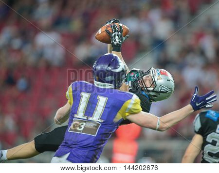 KLAGENFURT, AUSTRIA - JULY 11, 2015: DB Vincent Mueller (#23 Raiders) tackles WR Manuel Thaller (#11 Vikings)  in a game of the Austrian Football League.
