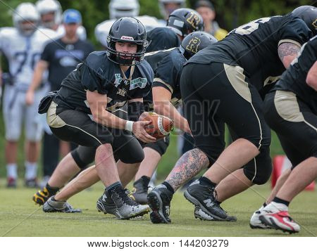 MOEDLING, AUSTRIA - MAY 24, 2015: QB Benjamin Braeuer (#15 Rangers) runs with the ball in a game of the Division I of the Austrian Football League.