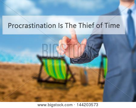 Procrastination Is The Thief Of Time -  Businessman Click On Virtual Touchscreen.