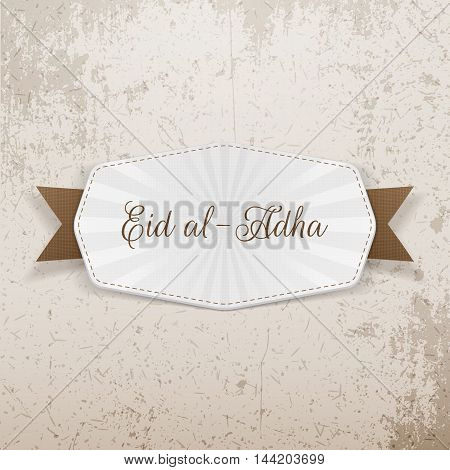 Eid al-Adha Emblem with Text and Ribbon