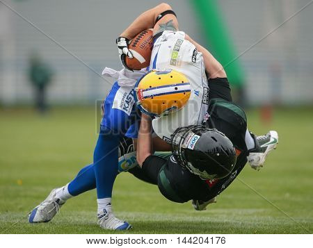 VIENNA, AUSTRIA - MAY 3, 2015: LB Fabio Baumgartner (#8 Dragons tackles WR Patrick Ehmann (#80 Giants) in a game of the Austrian Football League.