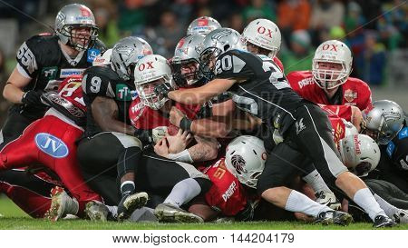 INNSBRUCK, AUSTRIA - MAY 2, 2015: QB Grant Enders (#14 Lions) is tackled in a game of the Big SIx Football League.