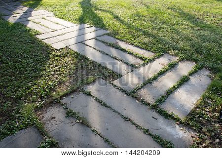 Stone foot path in the afternoon with shadow