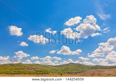 natural scenery with green hill and clouds on blue sky