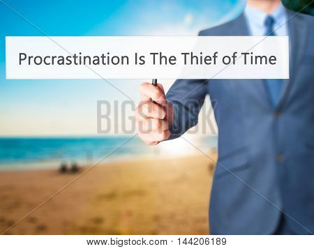 Procrastination Is The Thief Of Time - Business Man Showing Sign
