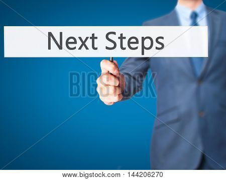 Next Steps - Business Man Showing Sign