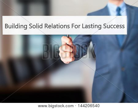Building Solid Relations For Lasting Success - Business Man Showing Sign