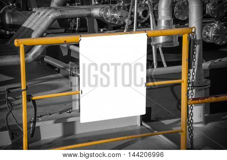 billboard blank for advertising poster at yellow tube on industrial background. Black and whie tone