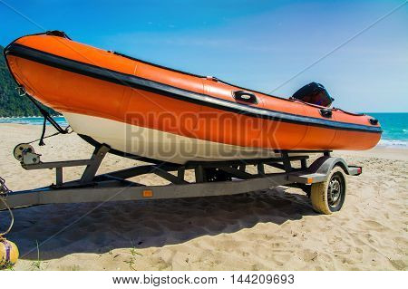 orange raft boat on the  beach for help people victim drowning