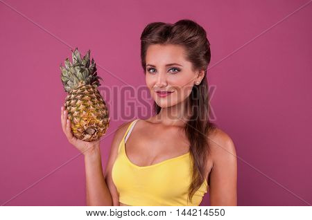 Caucasian woman hold Pineapple fruit smiling healthy and joyful model isolated on pink background.