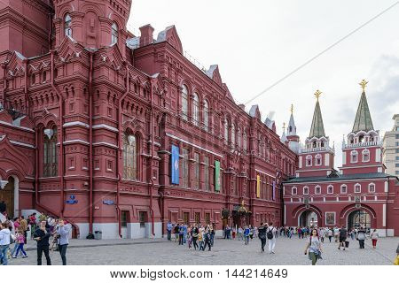 Moscow, Russia - July 07, 2016: People walk passing the building of the Historical Museum (Red Square 1)