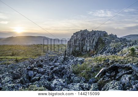 The one of the Ural rocks at the sunset