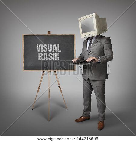 Visual basic text on blackboard and computer monitor on businessman head