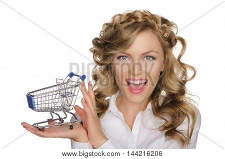 smiling woman with trolley for shopping isolated on white