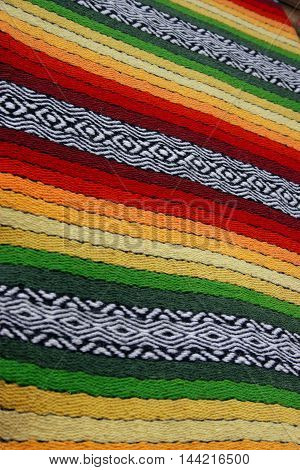 old hand made national patterned rug striped
