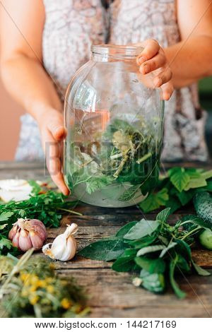 Fresh Colorful Salad In A Mason Jar. Mason Jar With Pickle Cucum
