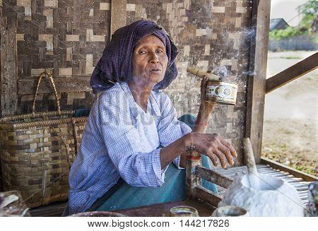 Bagan, Myanmar, September 2014: Old woman smoking a cigar