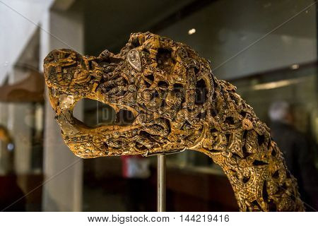 OSLO, NORWAY - JULY 1, 2016: It is ancient carved decoration in the form of the head of the beast from Viking Ship Museum.