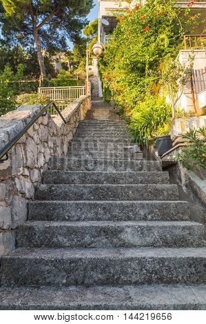 DUBROVNIK CROATIA - 10TH AUGUST 2016: Steps leading up between streets in the outskirts of Dubrovnik Old Town