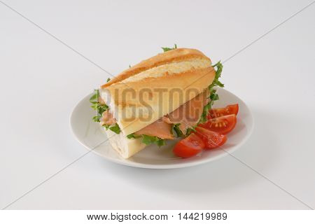 sandwich with smoked salmon on white plate