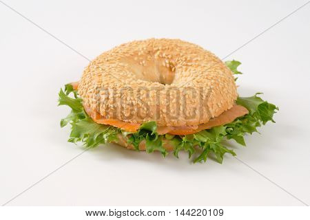 bagel sandwich with smoked salmon on white background
