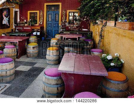 colorful cafe in Santorini - purple, yellow
