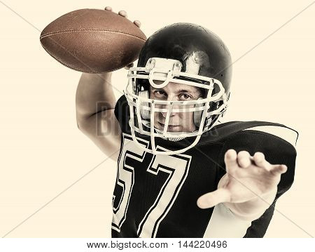 American football player close-up on white background. Toned photo.