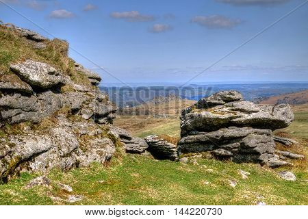 Chinkwell Tor, Dartmoor, near Widecombe- in-the- Moor,  Devon. Hound Tor clearly seen in the in the distance.