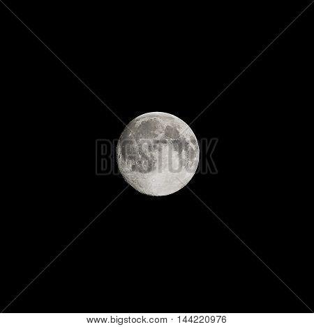 The fully moon in the dark sky