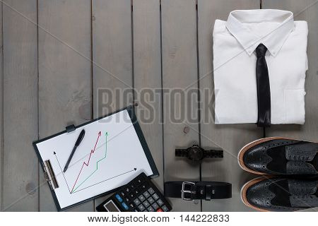 Businessman, Work Outfit On Grey Wooden Background. White Shirt With Black Tie, Watch, Belt, Oxford