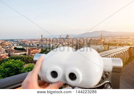 Florence cityscape view from Michelangelo square with telescope on the foreground in Italy