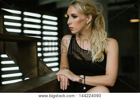 athletic woman in body sitting on the stairs portrait