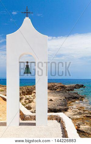 Agios Nikolaos. Small White Orthodox Bell Tower