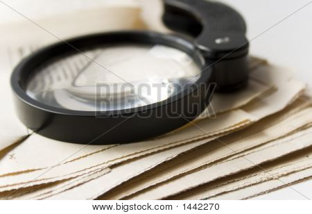 Magnifier And Newspaper