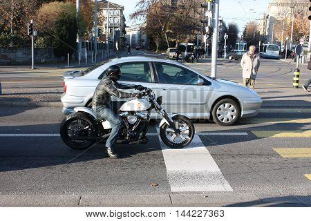 Zurich, Switzerland - November 27, 2011. Motorcyclist biker stopped at an intersection